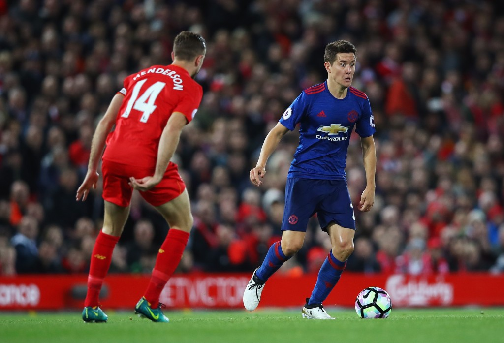 LIVERPOOL, ENGLAND - OCTOBER 17: Ander Herrera of Manchester United is closed down by Jordan Henderson of Liverpool during the Premier League match between Liverpool and Manchester United at Anfield on October 17, 2016 in Liverpool, England. (Photo by Clive Brunskill/Getty Images)