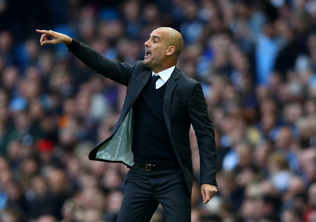 MANCHESTER, ENGLAND - OCTOBER 15: Josep Guardiola, Manager of Manchester City gives his team instructions during the Premier League match between Manchester City and Everton at Etihad Stadium on October 15, 2016 in Manchester, England. (Photo by Clive Brunskill/Getty Images)