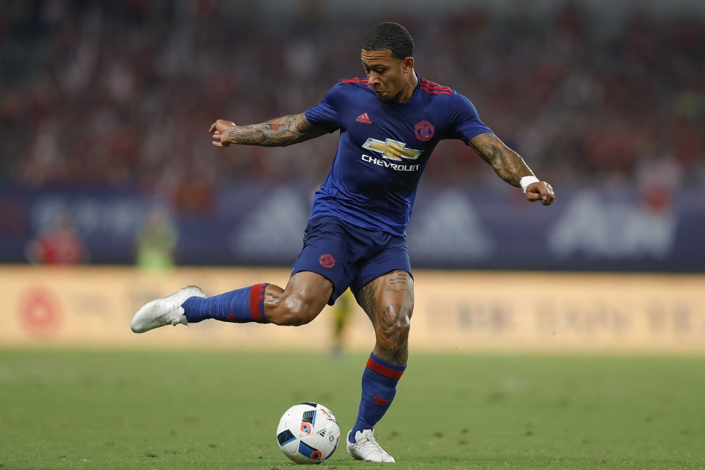 SHANGHAI, CHINA - JULY 22: Memphis Depay of Manchester United competes for the ball during the International Champions Cup match between Manchester United and Borussia Dortmund at Shanghai Stadium on July 22, 2016 in Shanghai, China. (Photo by Lintao Zhang/Getty Images)
