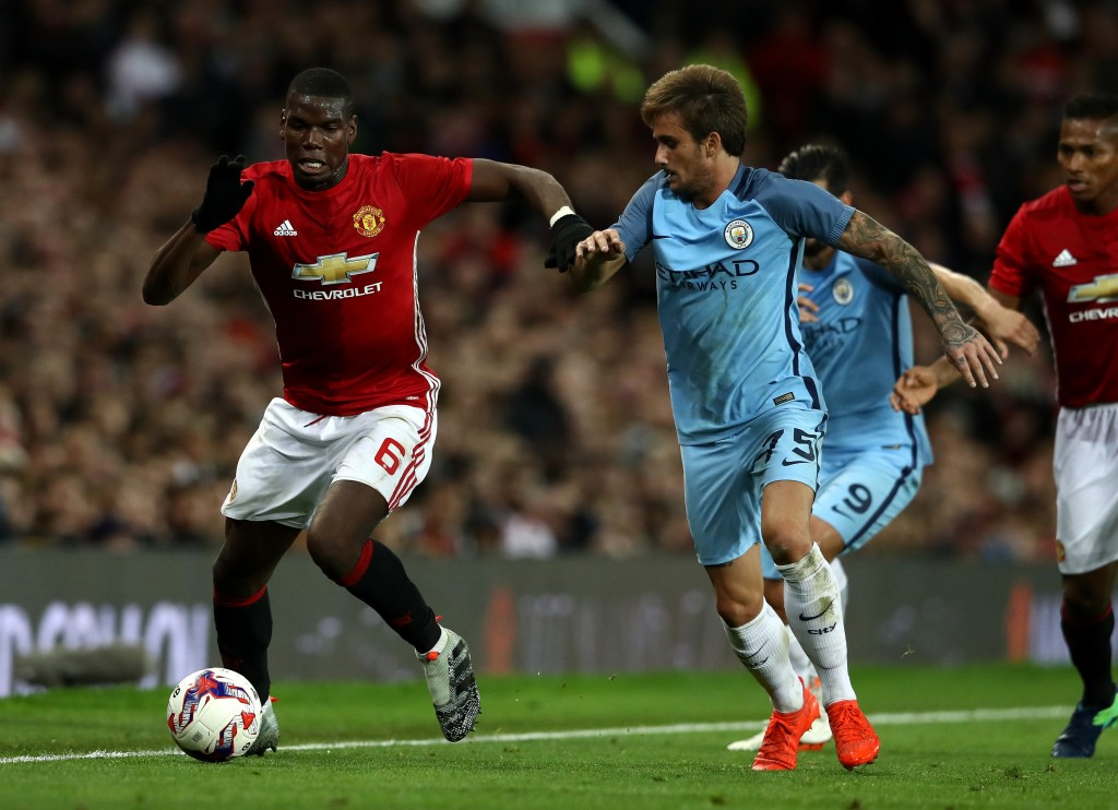MANCHESTER, ENGLAND - OCTOBER 26: Paul Pogba of Manchester United (L) takes on Aleix Garcia of Manchester City (R) during the EFL Cup fourth round match between Manchester United and Manchester City at Old Trafford on October 26, 2016 in Manchester, England. (Photo by David Rogers/Getty Images)