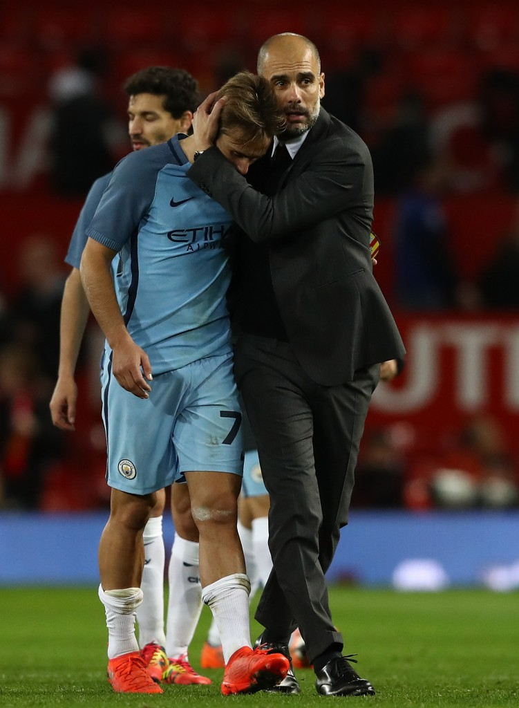 MANCHESTER, ENGLAND - OCTOBER 26: Josep Guardiola, Manager of Manchester City (R) embraces Aleix Garcia of Manchester City (L) after the final whistle during the EFL Cup fourth round match between Manchester United and Manchester City at Old Trafford on October 26, 2016 in Manchester, England. (Photo by David Rogers/Getty Images)