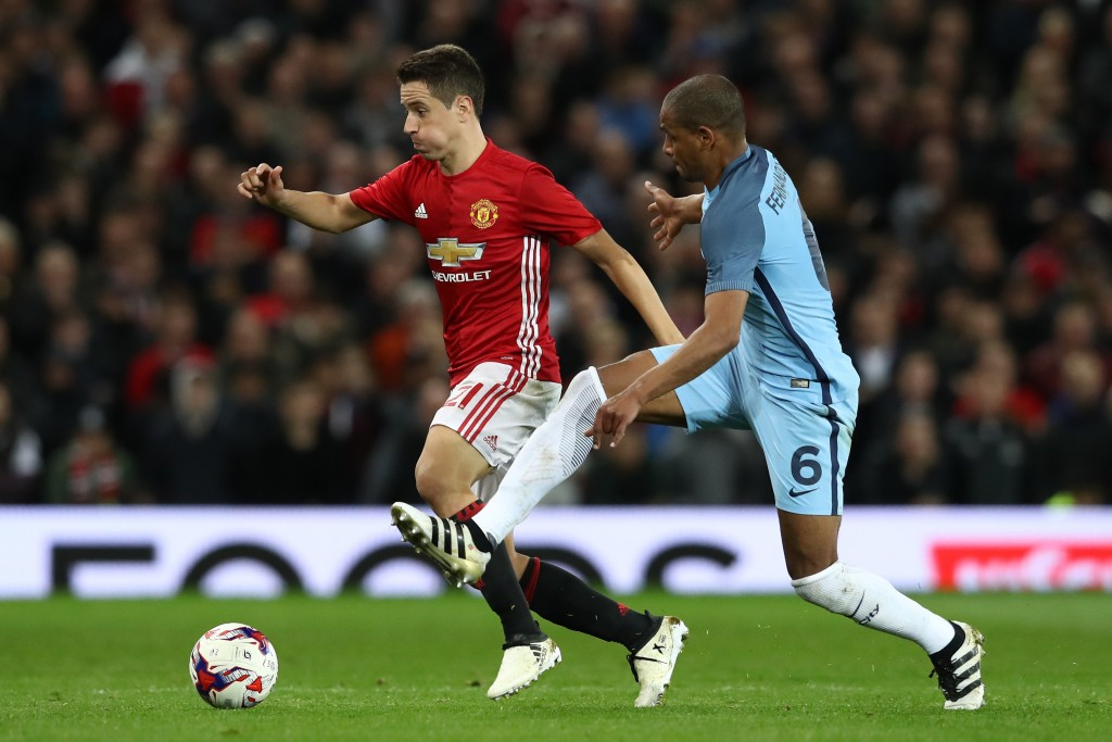 MANCHESTER, ENGLAND - OCTOBER 26: Ander Herrera of Manchester United (L) takes the ball past Fernando of Manchester City (R) during the EFL Cup fourth round match between Manchester United and Manchester City at Old Trafford on October 26, 2016 in Manchester, England. (Photo by David Rogers/Getty Images)