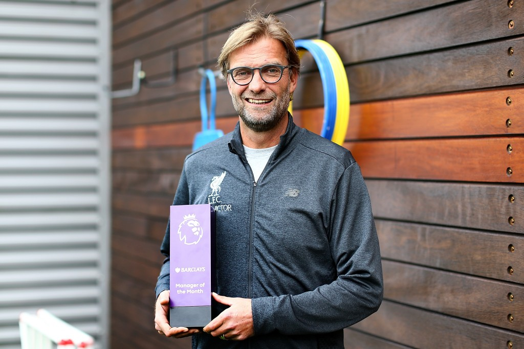 LIVERPOOL, ENGLAND - OCTOBER 13: Jurgen Klopp poses with the manager of the month trophy at Melwood Training Ground on October 13, 2016 in Liverpool, England. (Photo by Jan Kruger/Getty Images for Premier League)