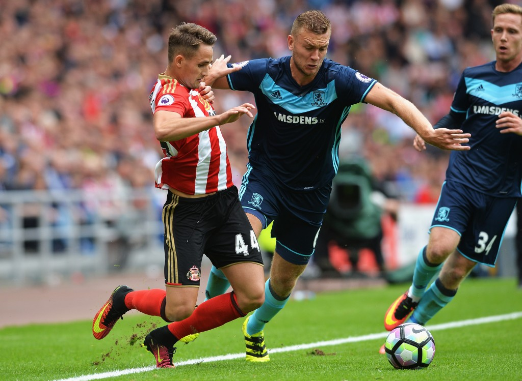 SUNDERLAND, ENGLAND - AUGUST 21: Adnan Januzaj of Sunderland takes on Ben Gibson of Middlesbrough during the Premier League match between Sunderland and Middlesbrough at Stadium of Light on August 21, 2016 in Sunderland, England. (Photo by Mark Runnacles/Getty Images)