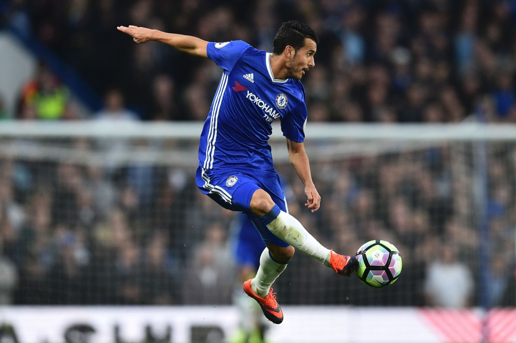 TOPSHOT - Chelsea's Spanish midfielder Pedro controls the ball during the English Premier League football match between Chelsea and Manchester United at Stamford Bridge in London on October 23, 2016. / AFP / GLYN KIRK / RESTRICTED TO EDITORIAL USE. No use with unauthorized audio, video, data, fixture lists, club/league logos or 'live' services. Online in-match use limited to 75 images, no video emulation. No use in betting, games or single club/league/player publications. / (Photo credit should read GLYN KIRK/AFP/Getty Images)
