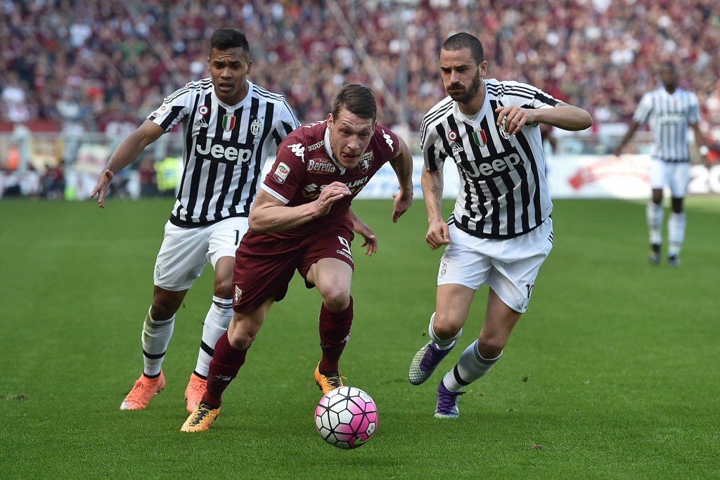 TURIN, ITALY - MARCH 20: Andrea Belotti (C) of Torino FC in action against Leonardo Bonucci (R) and Alex Sandro of Juventus FC during the Serie A match between Torino FC and Juventus FC at Stadio Olimpico di Torino on March 20, 2016 in Turin, Italy. (Photo by Valerio Pennicino/Getty Images)