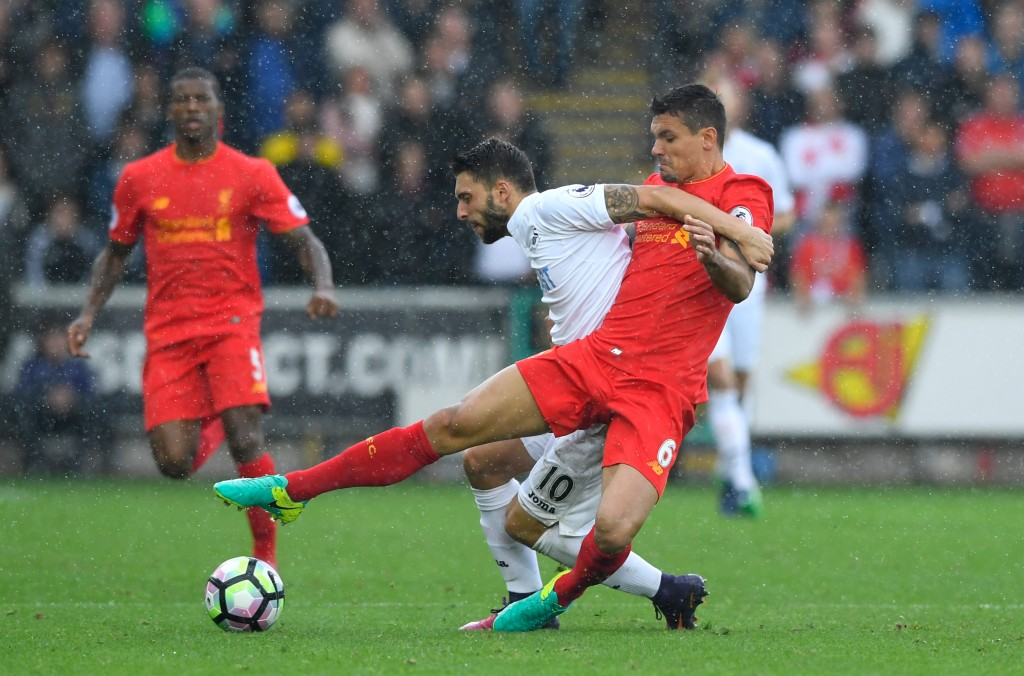 SWANSEA, WALES - OCTOBER 01:  Borja Gonzalez of Swansea City (L) and Dejan Lovren of Liverpool (R) battle for possession during the Premier League match between Swansea City and Liverpool at Liberty Stadium on October 1, 2016 in Swansea, Wales.  (Photo by Stu Forster/Getty Images)