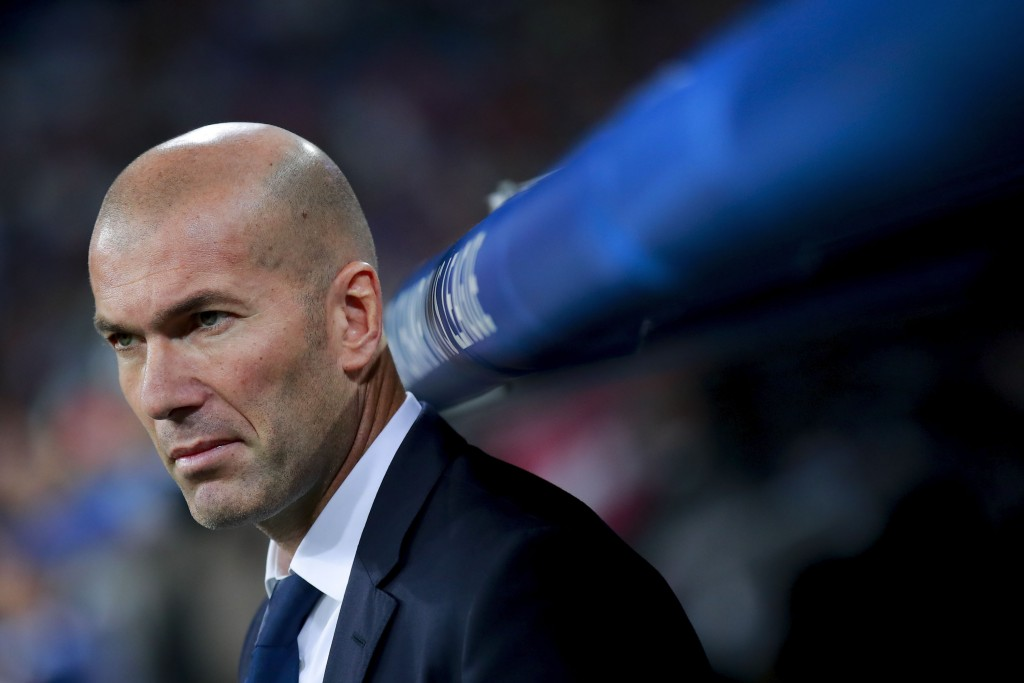MADRID, SPAIN - OCTOBER 18: Coach Zinedine Zidane of Real Madrid CF looks on ahead the bench prior to start  the UEFA Champions League group F match between Real Madrid CF and Legia Warszawa at Santiago Bernabeu stadium on October 18, 2016 in Madrid, Spain. (Photo by Gonzalo Arroyo Moreno/Getty Images)