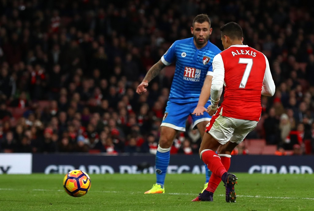 LONDON, ENGLAND - NOVEMBER 27: Alexis Sanchez of Arsenal (R) scores his sides third goal during the Premier League match between Arsenal and AFC Bournemouth at Emirates Stadium on November 27, 2016 in London, England. (Photo by Clive Rose/Getty Images)