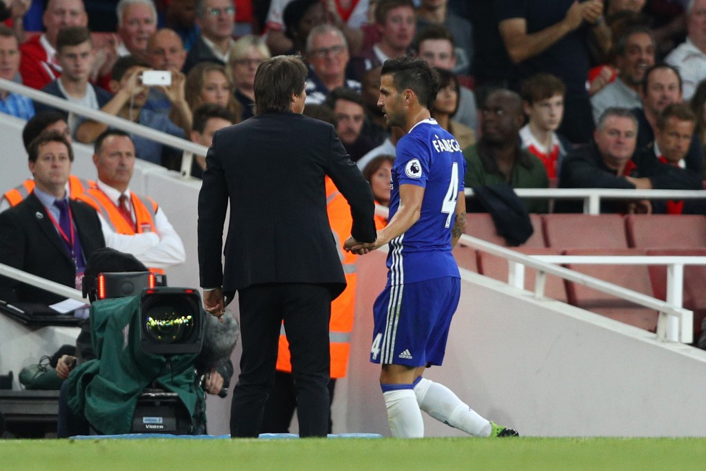 LONDON, ENGLAND - SEPTEMBER 24: Cesc Fabregas of Chelsea (R) speaks to Antonio Conte, Manager of Chelsea (L) after being subbed during the Premier League match between Arsenal and Chelsea at the Emirates Stadium on September 24, 2016 in London, England. (Photo by Paul Gilham/Getty Images)