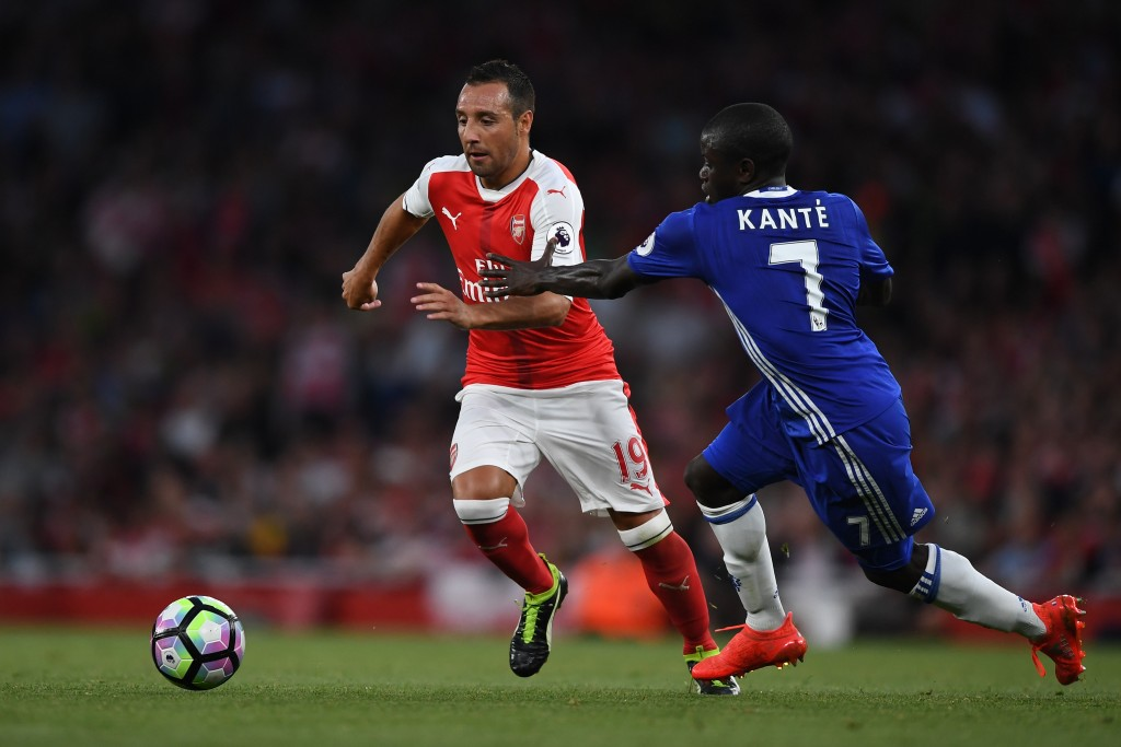 LONDON, ENGLAND - SEPTEMBER 24: Santi Cazorla of Arsenal (L) takes it past N'Golo Kante of Chelsea (R) during the Premier League match between Arsenal and Chelsea at the Emirates Stadium on September 24, 2016 in London, England. (Photo by Shaun Botterill/Getty Images)
