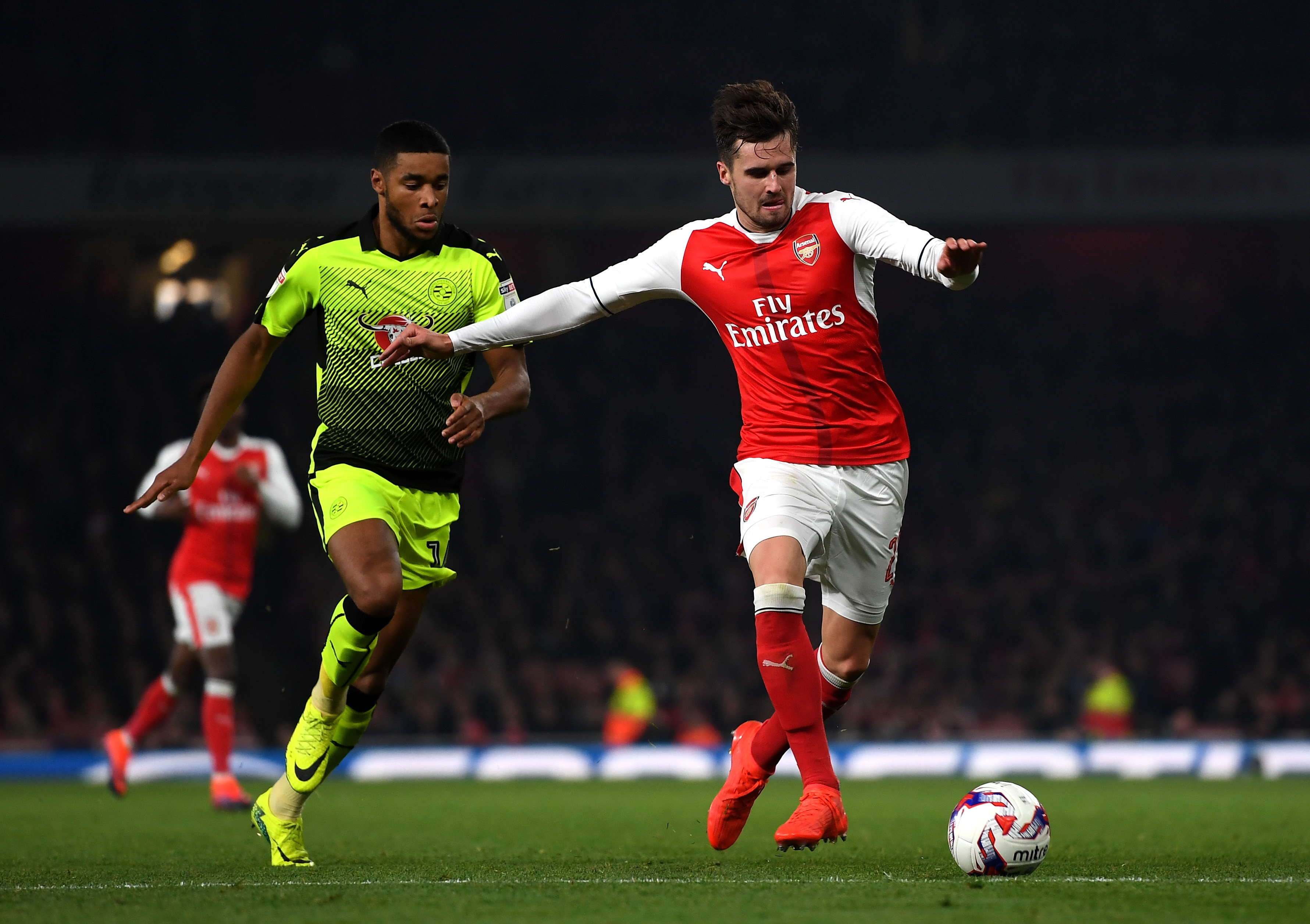 LONDON, ENGLAND - OCTOBER 25: Carl Jenkinson of Arsenal (R) is chased by Dominic Samuel of Reading (L) during the EFL Cup fourth round match between Arsenal and Reading at Emirates Stadium on October 25, 2016 in London, England. (Photo courtesy Michael Regan/Getty Images)