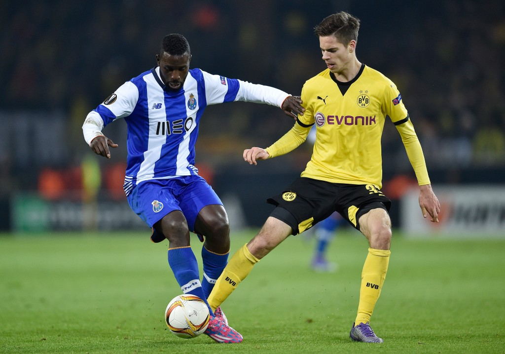 DORTMUND, GERMANY - FEBRUARY 18: Moussa Marega of FC Porto and Julian Weigl of Borussia Dortmund compete for the ball during the UEFA Europa League round of 32 first leg match between Borussia Dortmund and FC Porto at Signal Iduna Park on February 18, 2016 in Dortmund, Germany. (Photo by Dennis Grombkowski/Bongarts/Getty Images)