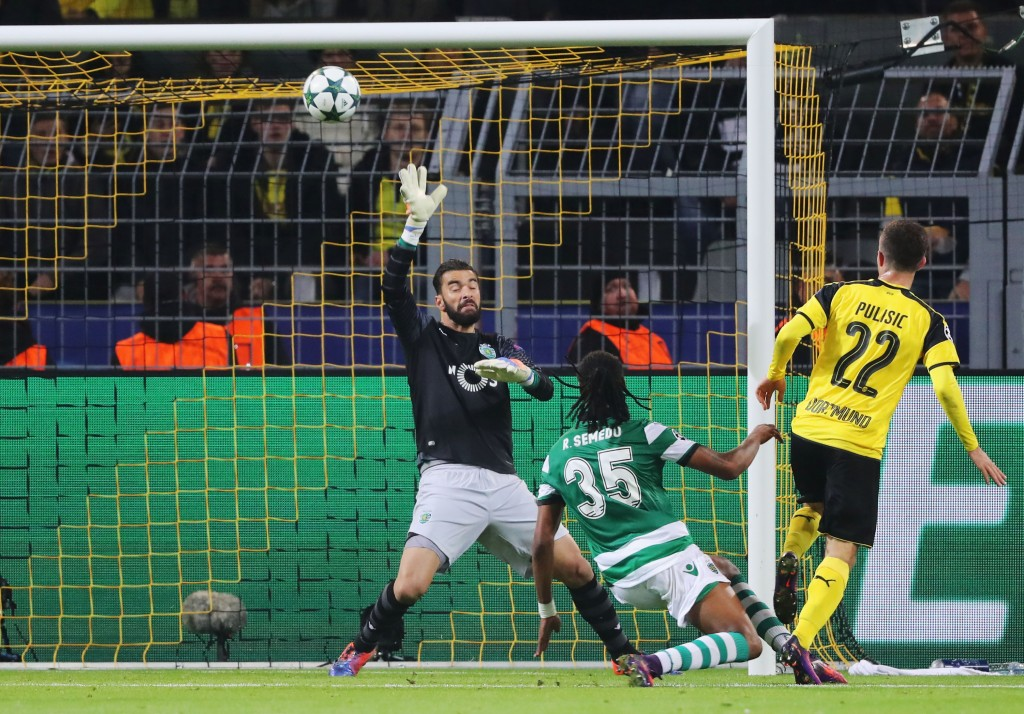 DORTMUND, GERMANY - NOVEMBER 02: Christian Pulisic of Borussia Dortmund (22) hits the crosssbar as he shoots past Rui Patricio of Sporting CP during the UEFA Champions League Group F match between Borussia Dortmund and Sporting Clube de Portugal at Signal Iduna Park on November 2, 2016 in Dortmund, Germany. (Photo by Simon Hofmann/Bongarts/Getty Images)