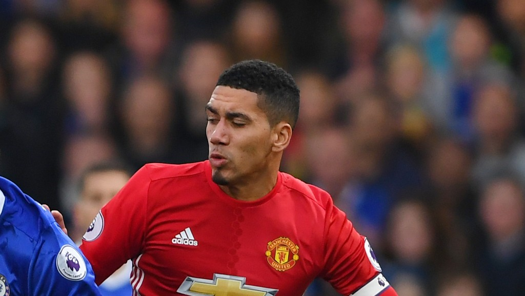 LONDON, ENGLAND - OCTOBER 23: Chris Smalling of Manchester United tackles Diego Costa of Chelsea during the Premier League match between Chelsea and Manchester United at Stamford Bridge on October 23, 2016 in London, England. (Photo by Mike Hewitt/Getty Images)