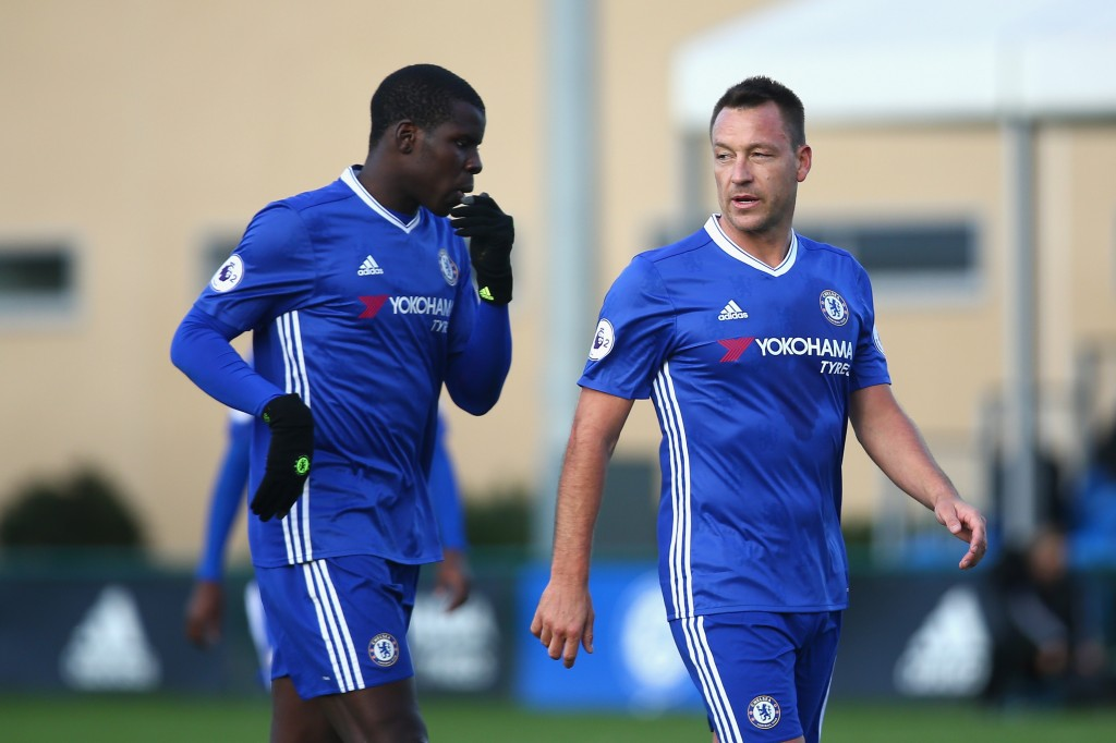 COBHAM, ENGLAND - NOVEMBER 21: Kurt Zouma of Chelsea (L) and John Terry (R) speak during the Premier League 2 match between Chelsea and Southampton at Chelsea Training Ground on November 21, 2016 in Cobham, England. (Photo by Alex Pantling/Getty Images)