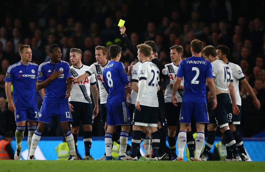 LONDON, ENGLAND - MAY 02: Referee Mark Clattenburg shows a yellow card to John Mikel Obi of Chelsea during the Barclays Premier League match between Chelsea and Tottenham Hotspur at Stamford Bridge on May 02, 2016 in London, England.jd (Photo by Ian Walton/Getty Images)