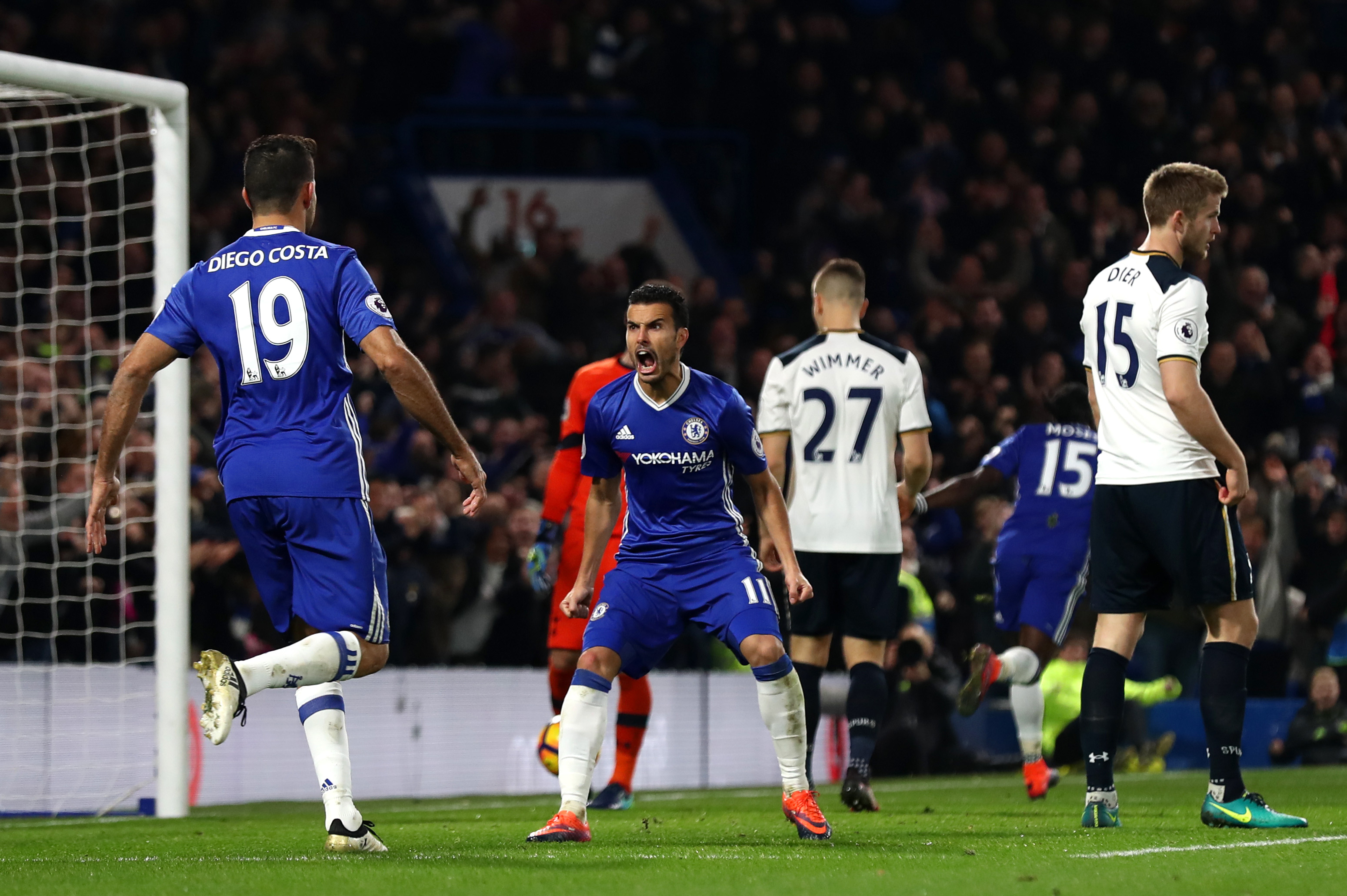 LONDON, ENGLAND - NOVEMBER 26: Pedro (C) of Chelsea celebrates scoring his team's first goal with his team mate Diego Costa (L) during the Premier League match between Chelsea and Tottenham Hotspur at Stamford Bridge on November 26, 2016 in London, England. (Photo by Clive Rose/Getty Images)