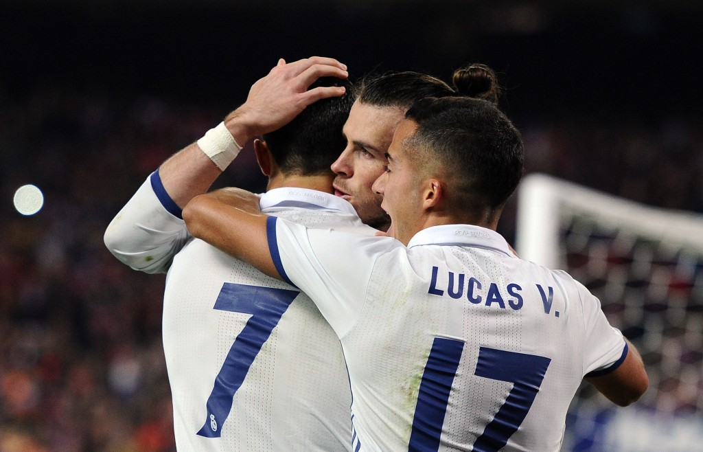 MADRID, SPAIN - NOVEMBER 19: Cristiano Ronaldo of Real Madrid celebrates with Gareth Bale and Lucas Vazquez after scoring Real's 2nd goal during the La Liga match between Club Atletico de Madrid and Real Madrid CF at Vicente Calderon Stadium on November 19, 2016 in Madrid, Spain. (Photo by Denis Doyle/Getty Images)