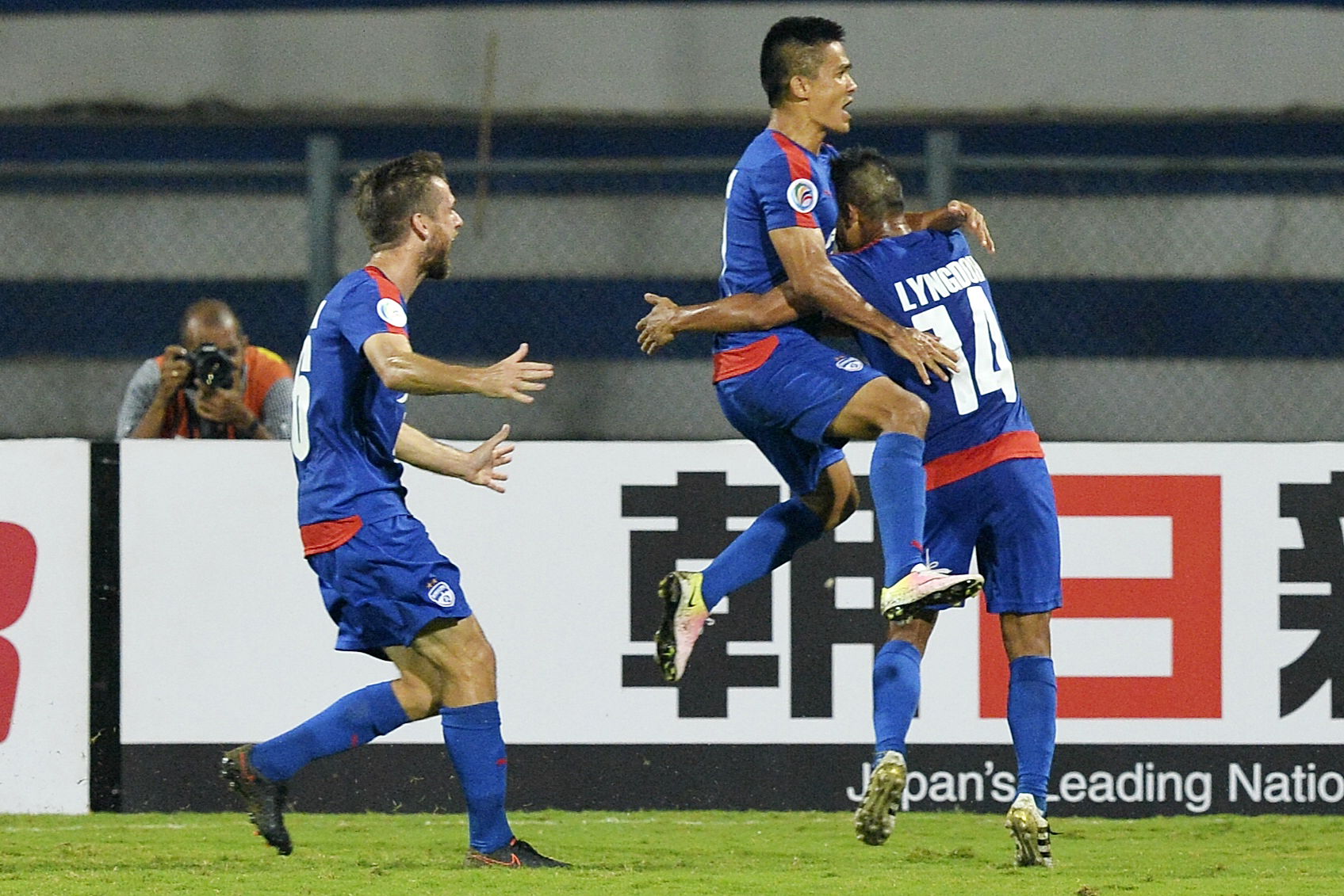Bengaluru's captain Sunil Chhetri (C) celebrates with his teammates after scoring during the 2016 Asian Football Confederation (AFC) Cup semi-final second leg football match between Bengaluru FC and Johor Darul Ta'zim at the Shree Kanteerava stadium in Bangalore, on October 19, 2016. The Sunil-Vineeth-Eugene combination will be the key again for Bengaluru FC / AFP / MANJUNATH KIRAN (Photo credit should read MANJUNATH KIRAN/AFP/Getty Images)