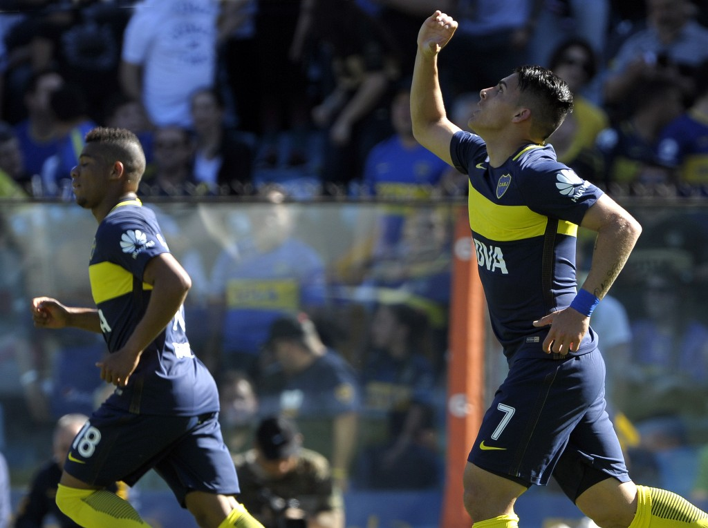 Boca Juniors' forward Cristian Pavon (R) celebrates after scoring a goal against Temperley during their Argentina First Division football match at La Bombonera stadium, in Buenos Aires, on October 29, 2016. / AFP / ALEJANDRO PAGNI (Photo credit should read ALEJANDRO PAGNI/AFP/Getty Images)
