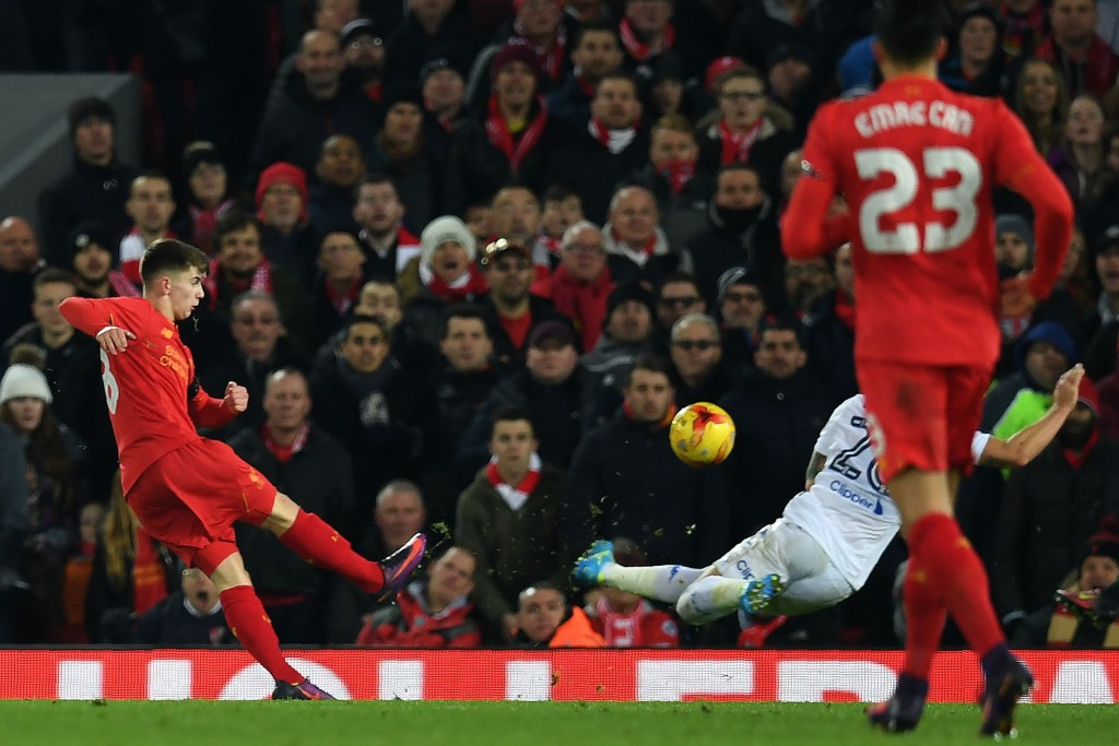 Liverpool's Welsh striker Ben Woodburn scores his team's second goal during the EFL (English Football League) Cup quarter-final football match between Liverpool and Leeds United at Anfield in Liverpool, north west England on November 29, 2016. / AFP / Paul ELLIS / RESTRICTED TO EDITORIAL USE. No use with unauthorized audio, video, data, fixture lists, club/league logos or 'live' services. Online in-match use limited to 75 images, no video emulation. No use in betting, games or single club/league/player publications. / (Photo credit should read PAUL ELLIS/AFP/Getty Images)