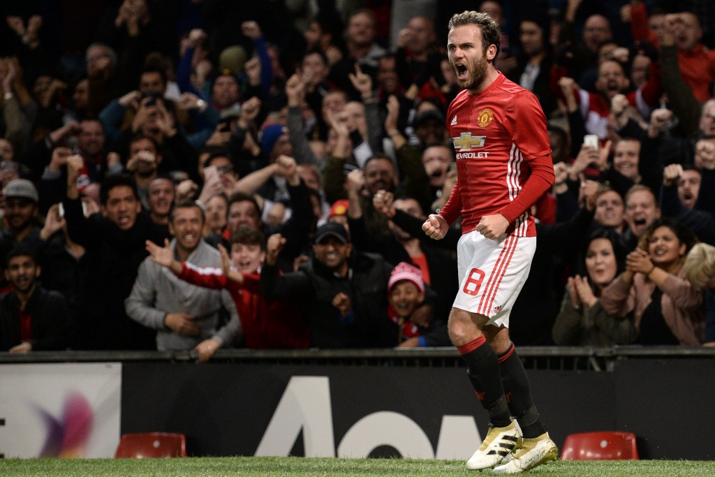 Manchester United's Spanish midfielder Juan Mata celebrates after scoring the opening goal of the EFL (English Football League) Cup fourth round match between Manchester United and Manchester City at Old Trafford in Manchester, north west England on October 26, 2016. / AFP / Oli SCARFF / RESTRICTED TO EDITORIAL USE. No use with unauthorized audio, video, data, fixture lists, club/league logos or 'live' services. Online in-match use limited to 75 images, no video emulation. No use in betting, games or single club/league/player publications. / (Photo credit should read OLI SCARFF/AFP/Getty Images)