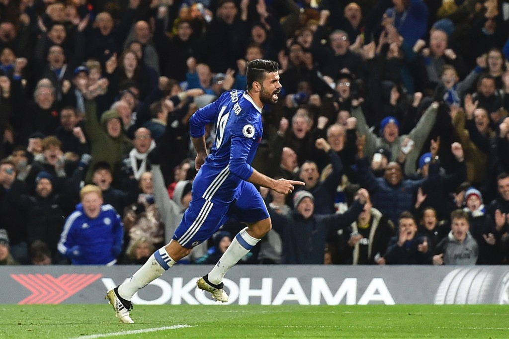 Chelsea's Brazilian-born Spanish striker Diego Costa celebrates after scoring their third goal during the English Premier League football match between Chelsea and Everton at Stamford Bridge in London on November 5, 2016. / AFP / Glyn KIRK / RESTRICTED TO EDITORIAL USE. No use with unauthorized audio, video, data, fixture lists, club/league logos or 'live' services. Online in-match use limited to 75 images, no video emulation. No use in betting, games or single club/league/player publications. / (Photo credit should read GLYN KIRK/AFP/Getty Images)