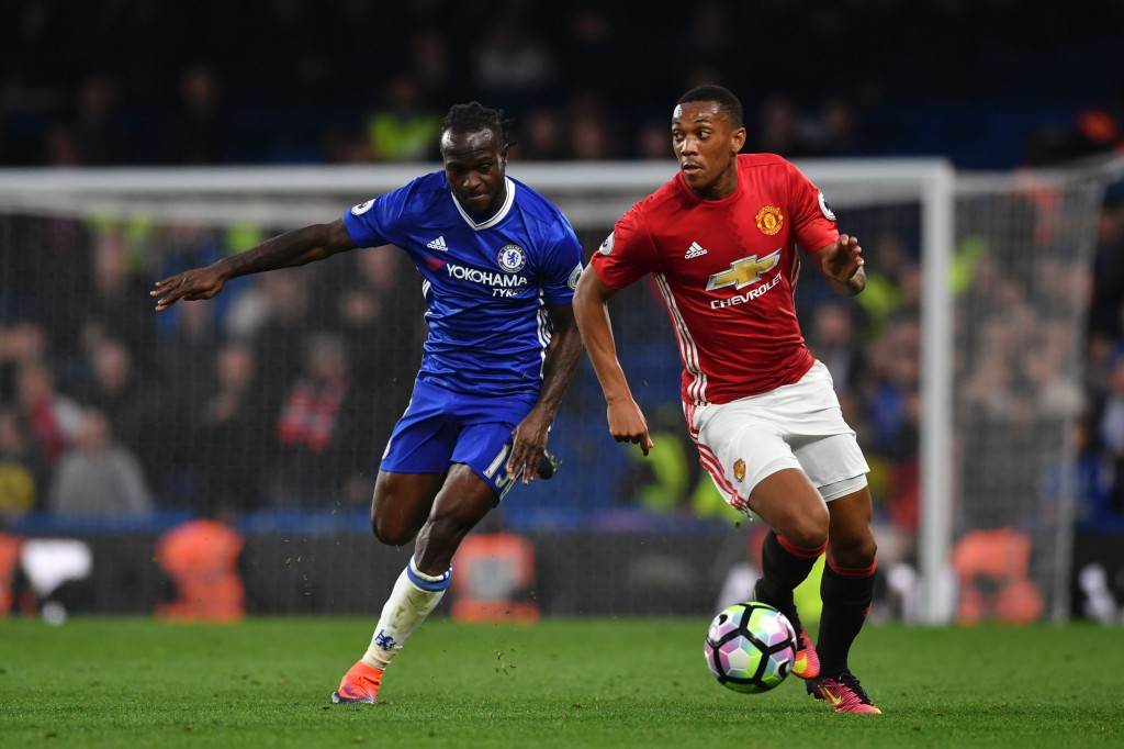 Manchester United's French striker Anthony Martial (R) takes on Chelsea's Nigerian midfielder Victor Moses (L) during the English Premier League football match between Chelsea and Manchester United at Stamford Bridge in London on October 23, 2016. / AFP / BEN STANSALL / RESTRICTED TO EDITORIAL USE. No use with unauthorized audio, video, data, fixture lists, club/league logos or 'live' services. Online in-match use limited to 75 images, no video emulation. No use in betting, games or single club/league/player publications. / (Photo credit should read BEN STANSALL/AFP/Getty Images)