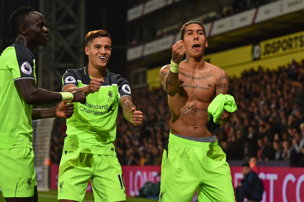 Liverpool's Brazilian midfielder Roberto Firmino (R) celebrates with Liverpool's Senegalese midfielder Sadio Mane (L) and Liverpool's Brazilian midfielder Philippe Coutinho after scoring their fourth goal during the English Premier League football match between Crystal Palace and Liverpool at Selhurst Park in south London on October 29, 2016. / AFP / Glyn KIRK / RESTRICTED TO EDITORIAL USE. No use with unauthorized audio, video, data, fixture lists, club/league logos or 'live' services. Online in-match use limited to 75 images, no video emulation. No use in betting, games or single club/league/player publications. / (Photo credit should read GLYN KIRK/AFP/Getty Images)