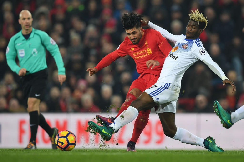 Liverpool's German midfielder Emre Can (L) plays the ball under pressure from Sunderland's Gabonese midfielder Didier N'Dong (R) during the English Premier League football match between Liverpool and Sunderland at Anfield in Liverpool, north west England on November 26, 2016. / AFP / Paul ELLIS / RESTRICTED TO EDITORIAL USE. No use with unauthorized audio, video, data, fixture lists, club/league logos or 'live' services. Online in-match use limited to 75 images, no video emulation. No use in betting, games or single club/league/player publications. / (Photo credit should read PAUL ELLIS/AFP/Getty Images)