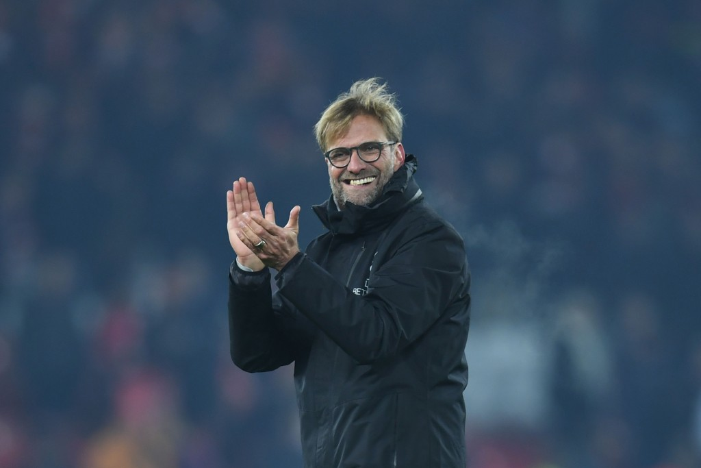 Liverpool's German manager Jurgen Klopp gestures to the crowd at the end of the English Premier League football match between Liverpool and Sunderland at Anfield in Liverpool, north west England on November 26, 2016. / AFP / Paul ELLIS / RESTRICTED TO EDITORIAL USE. No use with unauthorized audio, video, data, fixture lists, club/league logos or 'live' services. Online in-match use limited to 75 images, no video emulation. No use in betting, games or single club/league/player publications. / (Photo credit should read PAUL ELLIS/AFP/Getty Images)