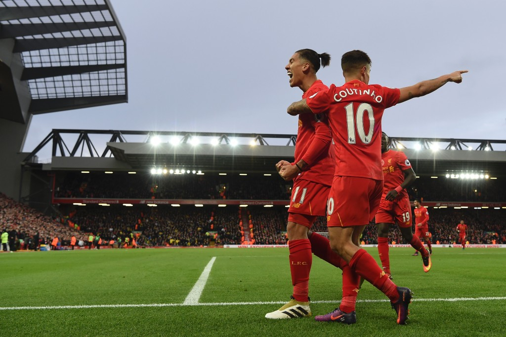 Liverpool's Brazilian midfielder Roberto Firmino (L) celebrates scoring his team's fourth goal Liverpool's Brazilian midfielder Philippe Coutinho with during the English Premier League football match between Liverpool and Watford at Anfield in Liverpool, north west England on November 6, 2016. / AFP / PAUL ELLIS / RESTRICTED TO EDITORIAL USE. No use with unauthorized audio, video, data, fixture lists, club/league logos or 'live' services. Online in-match use limited to 75 images, no video emulation. No use in betting, games or single club/league/player publications. / (Photo credit should read PAUL ELLIS/AFP/Getty Images)