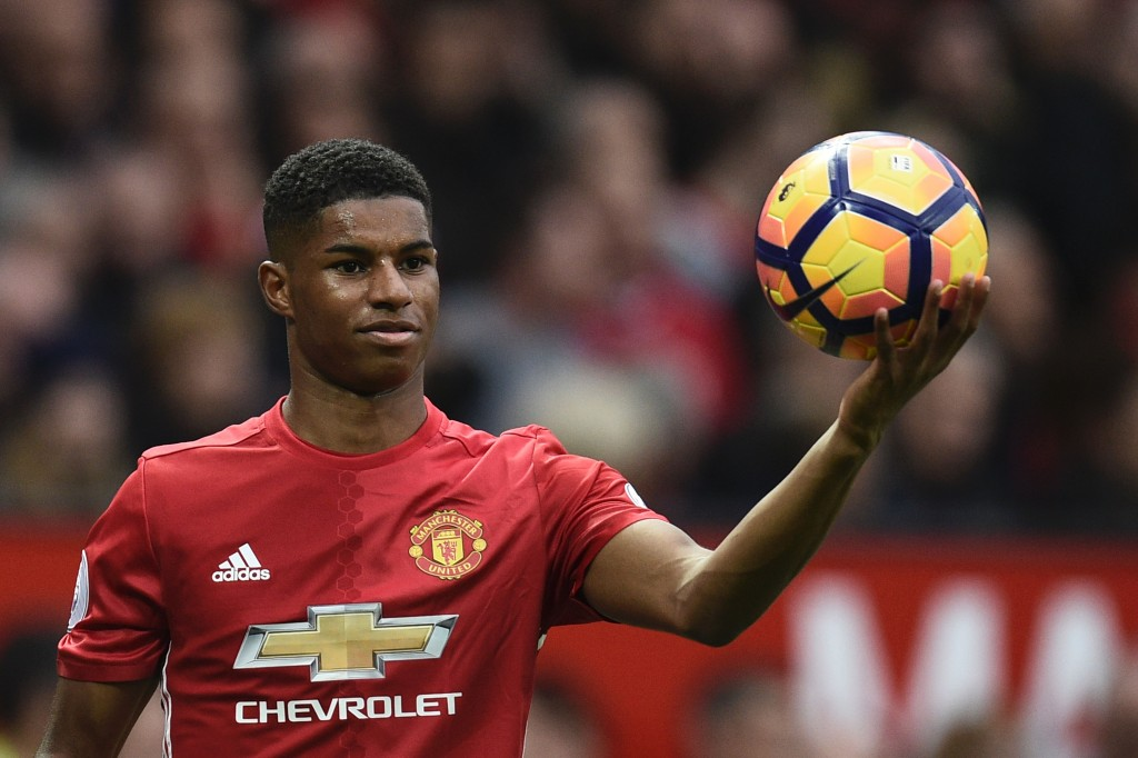 Manchester United's English striker Marcus Rashford holds the ball on the touchline ahead of a throw in during the English Premier League football match between Manchester United and Burnley at Old Trafford in Manchester, north west England, on October 29, 2016. / AFP / OLI SCARFF / RESTRICTED TO EDITORIAL USE. No use with unauthorized audio, video, data, fixture lists, club/league logos or 'live' services. Online in-match use limited to 75 images, no video emulation. No use in betting, games or single club/league/player publications. / (Photo credit should read OLI SCARFF/AFP/Getty Images)