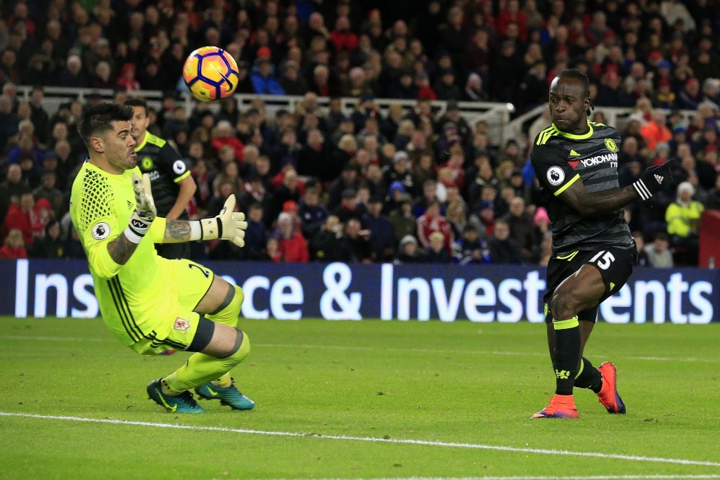 Chelsea's Nigerian midfielder Victor Moses (R) shoots past Middlesbrough's Spanish goalkeeper Victor Valdes but fails to score during the English Premier League football match between Middlesbrough and Cheslea at Riverside Stadium in Middlesbrough, northeast England on November 20, 2016. / AFP / Lindsey PARNABY / RESTRICTED TO EDITORIAL USE. No use with unauthorized audio, video, data, fixture lists, club/league logos or 'live' services. Online in-match use limited to 75 images, no video emulation. No use in betting, games or single club/league/player publications. / (Photo credit should read LINDSEY PARNABY/AFP/Getty Images)