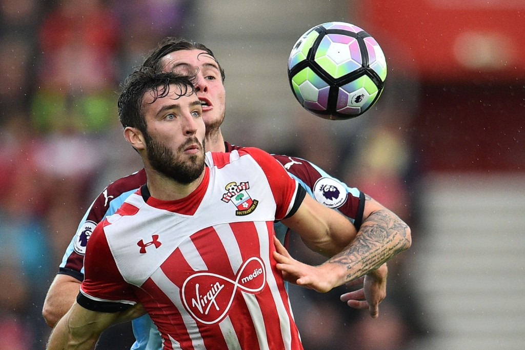 Southampton's English midfielder Sam McQueen (L) vies with Burnley's Australian midfielder Aiden O'Neill during the English Premier League football match between Southampton and Burnley at St Mary's Stadium in Southampton, southern England on October 16, 2016. / AFP / GLYN KIRK / RESTRICTED TO EDITORIAL USE. No use with unauthorized audio, video, data, fixture lists, club/league logos or 'live' services. Online in-match use limited to 75 images, no video emulation. No use in betting, games or single club/league/player publications. / (Photo credit should read GLYN KIRK/AFP/Getty Images)