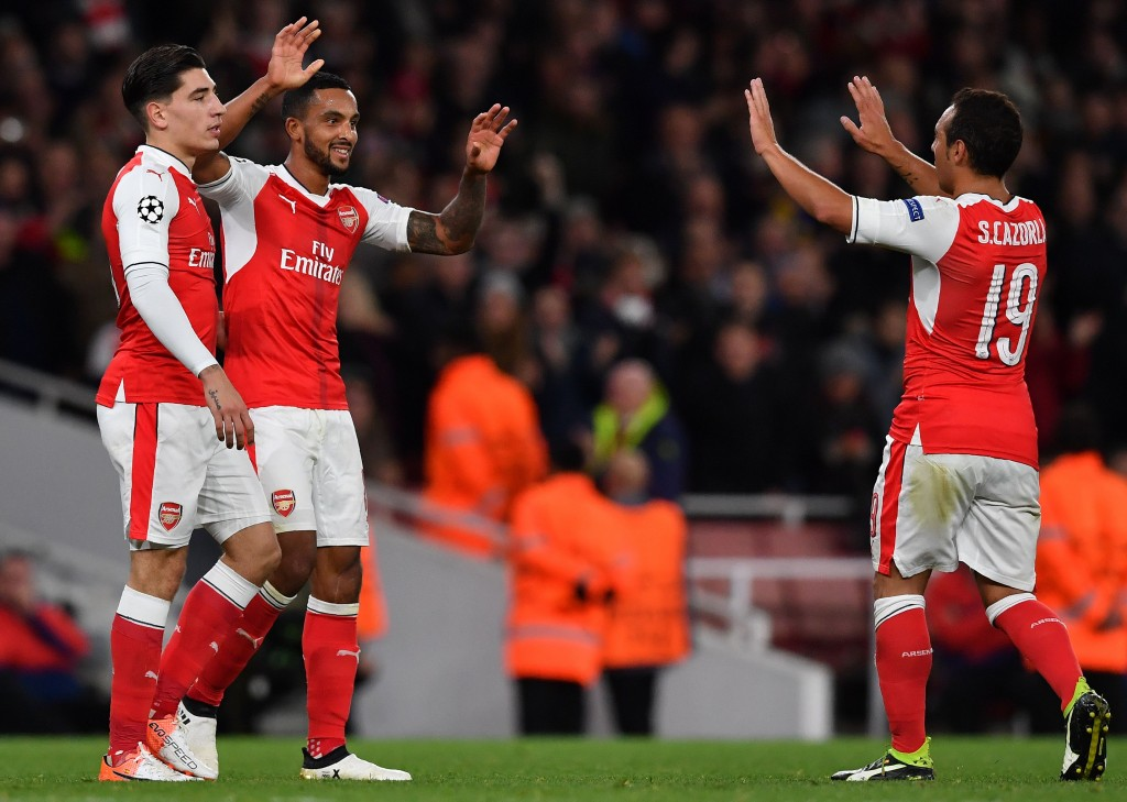Arsenal's English midfielder Theo Walcott (C) celebrates scoring his team's second goal with Arsenal's Spanish defender Hector Bellerin (L) and Arsenal's Spanish midfielder Santi Cazorla during the UEFA Champions League Group A football match between Arsenal and Ludogorets Razgrad at The Emirates Stadium in London on October 19, 2016. / AFP / BEN STANSALL (Photo credit should read BEN STANSALL/AFP/Getty Images)