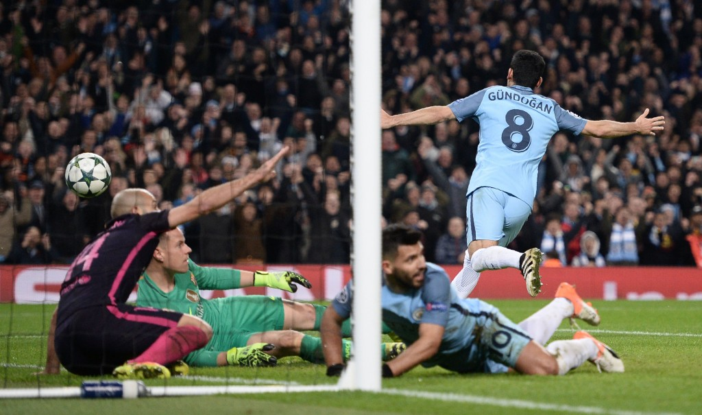 Manchester City's German midfielder Ilkay Gundogan (R) celebrates scoring his team's third goal during the UEFA Champions League group C football match between Manchester City and Barcelona at the Etihad Stadium in Manchester, north west England on November 1, 2016. (Photo by OLI SCARFF/AFP/Getty Images)