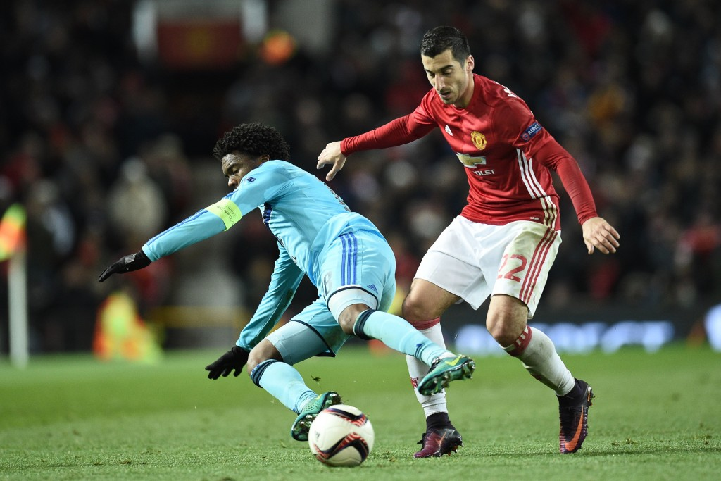 Manchester United's Armenian midfielder Henrikh Mkhitaryan (R) challenges Feyenoord's Dutch defender Miquel Nelom (L) during the UEFA Europa League group A football match between Manchester United and Feyenoord at Old Trafford stadium in Manchester, north-west England, on November 24, 2016. / AFP / Oli SCARFF        (Photo credit should read OLI SCARFF/AFP/Getty Images)