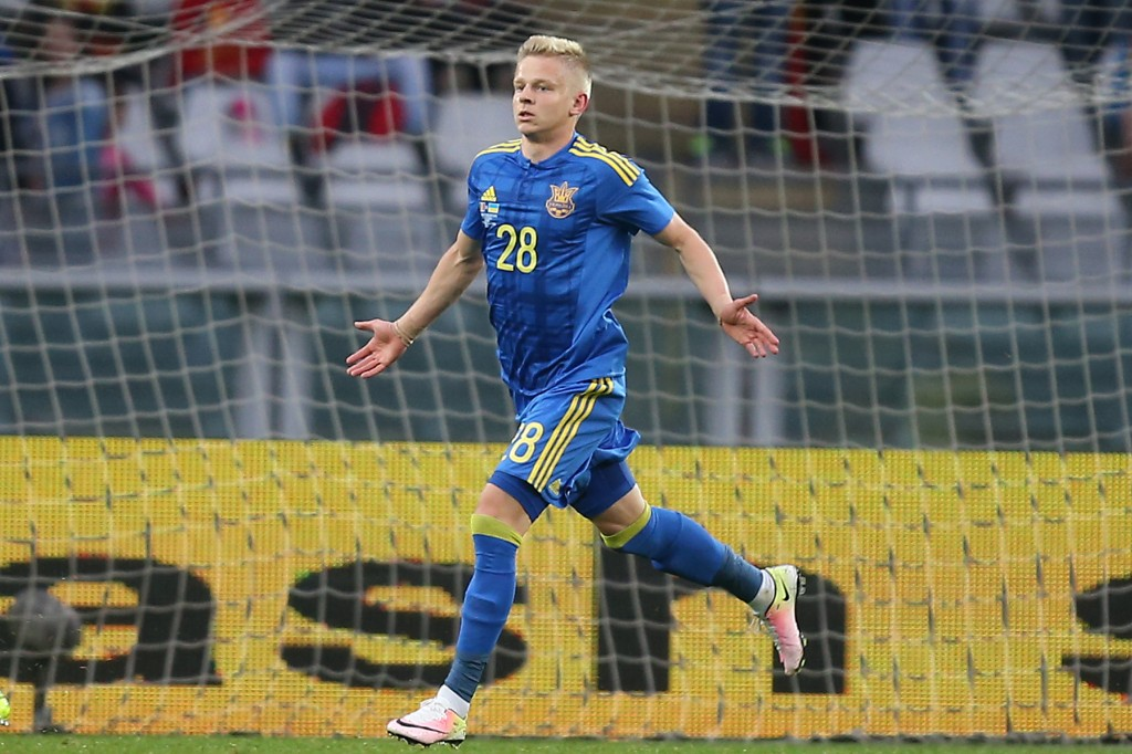 "Ukraine's forward Zinchenko Oleksandr celebrates after scoring during the international friendly football match between Romania and Ukraine at ""Grande Torino Stadium"" in Turin, on May 29, 2016. / AFP / MARCO BERTORELLO (Photo credit should read MARCO BERTORELLO/AFP/Getty Images)"
