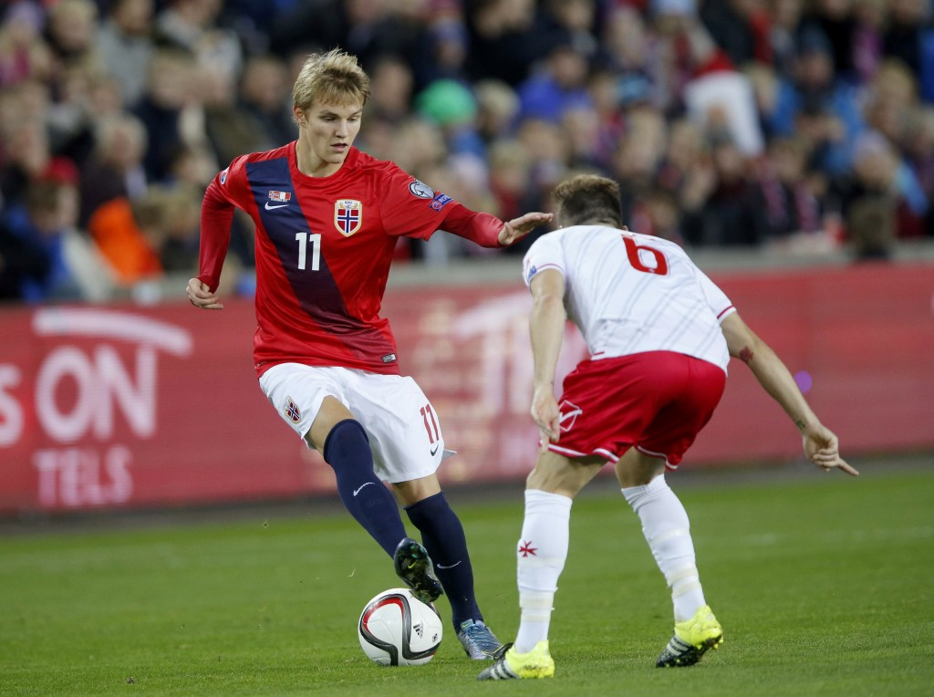 Norway`s Martin Odegaard (L) vies with Malta's Paul Fenech during the Euro 2016 Group A qualifying football match between Norway and Malta in Oslo on October 10, 2015. AFP PHOTO / NTB SCANPIX / CORNELIUS POPPE ++++ NORWAY OUT (Photo credit should read CORNELIUS POPPE/AFP/Getty Images)