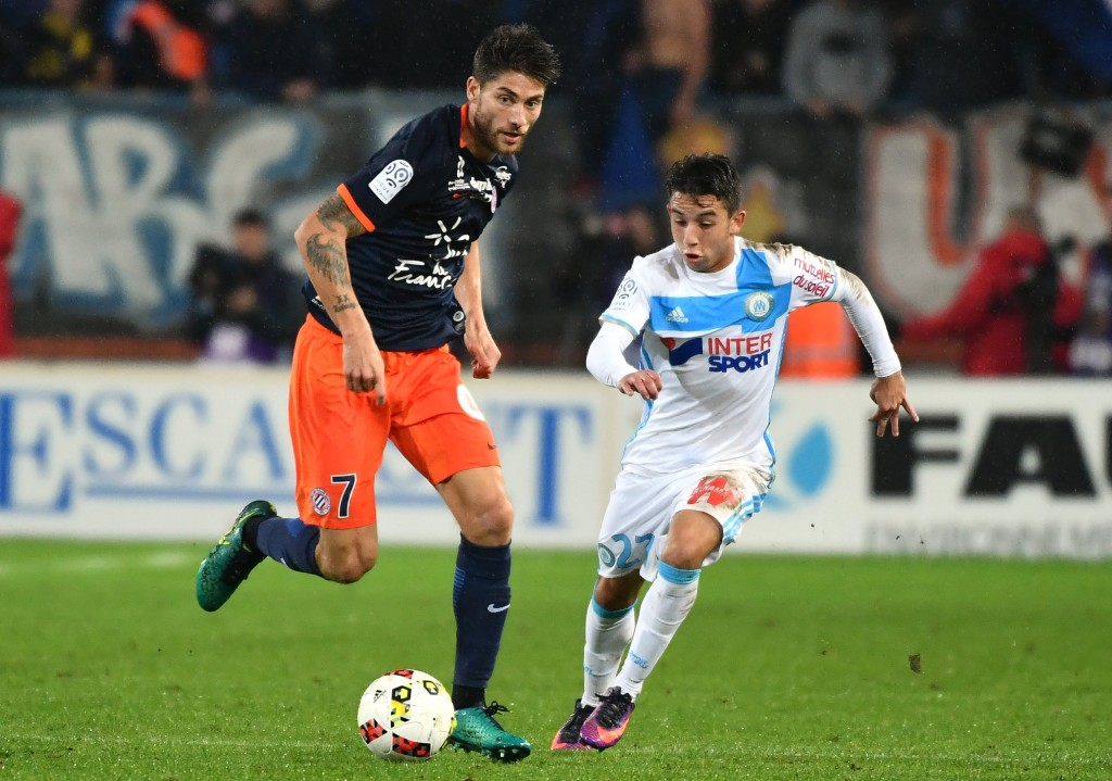 Montpellier's French midfielder Paul Lasne (L) vies with Olympique de Marseille's French midfielder Maxime Lopez during the French L1 football match between Montpellier and Marseille at the La Mosson Stadium in Montpellier, southern France, on November 4, 2016. (Photo by PASCAL GUYOT/AFP/Getty Images)