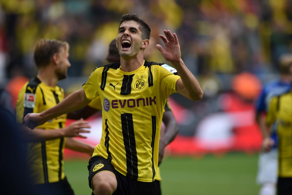 Dortmund's US midfielder Christian Pulisic celebrates during the German first division Bundesliga football match of Borussia Dortmund vs SV Darmstadt 98 in Dortmund, western Germany, on September 17, 2016. / AFP / PATRIK STOLLARZ / RESTRICTIONS: DURING MATCH TIME: DFL RULES TO LIMIT THE ONLINE USAGE TO 15 PICTURES PER MATCH AND FORBID IMAGE SEQUENCES TO SIMULATE VIDEO. == RESTRICTED TO EDITORIAL USE == FOR FURTHER QUERIES PLEASE CONTACT DFL DIRECTLY AT + 49 69 650050 (Photo credit should read PATRIK STOLLARZ/AFP/Getty Images)