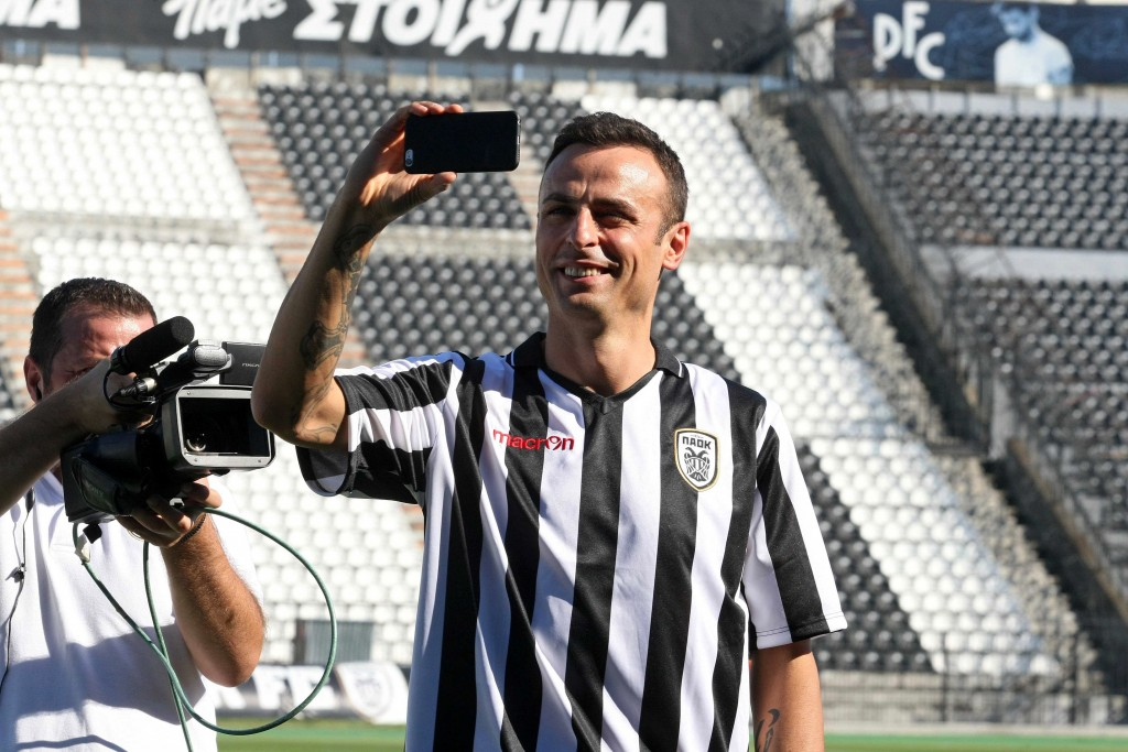 PAOK's new Bulgarian foward Dimitar Berbatov takes a selfie during his presentation at the Toumpa Stadium in Thessaloniki on September 3, 2015. Berbatov has signed to play for one season with PAOK, the Greek Super League club announced on September 3, 2015. (Photo by Sakis Mitrolidis/AFP/Getty Images)