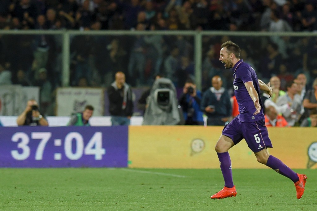 """Fiorentina's midfielder from Croatia Milan Badelj celebrates after scoring against AS Roma during the Italian Serie A football match Fiorentina vs Roma, on September 18, 2016 at Florence's """"Artemio Franchi"""" comunal stadium. / AFP / ANDREAS SOLARO (Photo credit should read ANDREAS SOLARO/AFP/Getty Images)"""