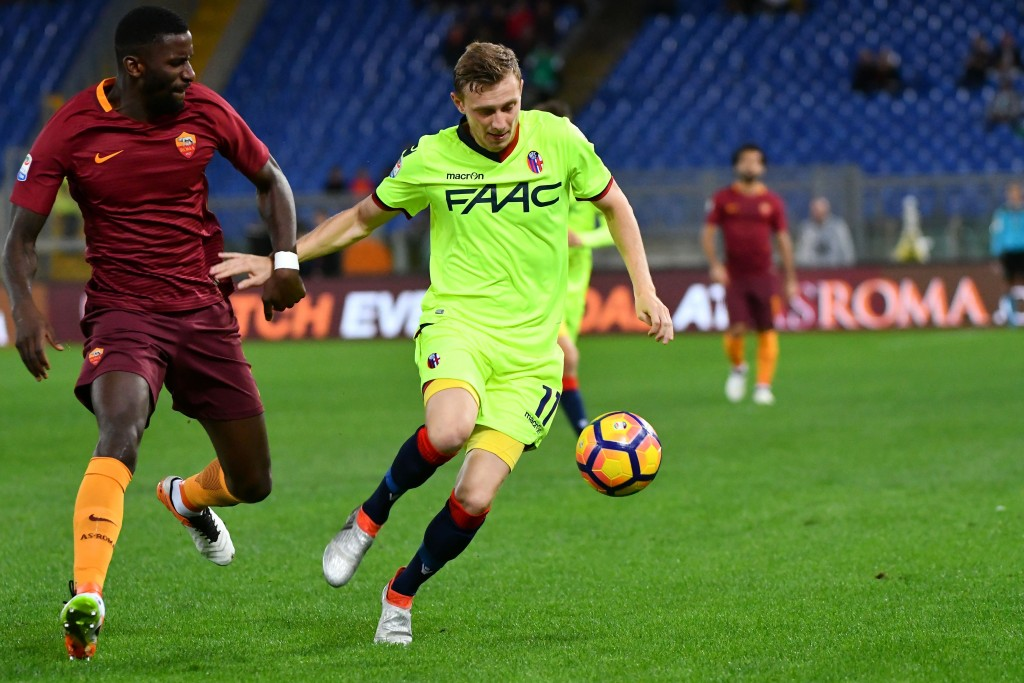 AS Roma's German defender Antonio Rudiger (L) vies Bologna's midfielder from Czech Republic Ladislav Krejci during the Italian Serie A football match AS Roma vs Bologna at the Olympic stadium in Rome, on November 6, 2016. / AFP / VINCENZO PINTO (Photo credit should read VINCENZO PINTO/AFP/Getty Images)