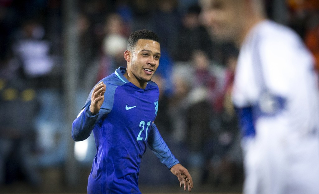 Netherlands' midfielder Memphis Depay celebrates after scoring a goal during the 2018 FIFA World Cup European zone group A qualifying football match between Luxembourg and Netherlands at the Josy Barthel stadium in Luxembourg on November 13, 2016. / AFP / ANP / Jerry Lampen / Netherlands OUT (Photo credit should read JERRY LAMPEN/AFP/Getty Images)