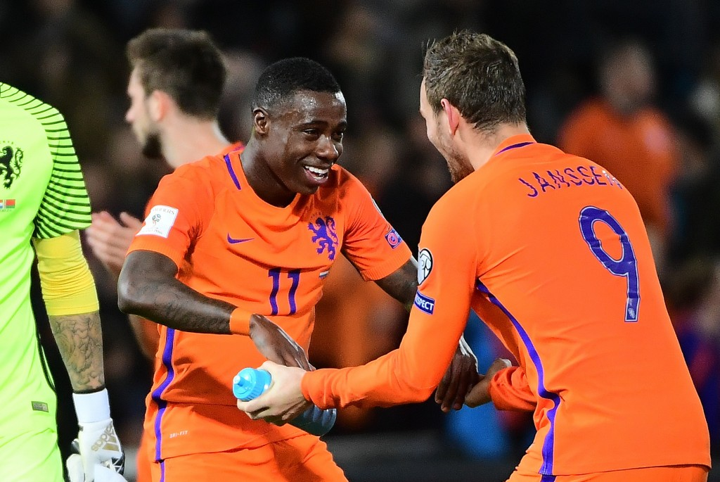 Netherlands' Quincy Promes (C) and Netherlands' Vincent Janssen (R) celebrate after their team's victory during the FIFA World Cup 2018 qualification football match between The Netherlands and Belarus at Feyenoord Stadium in Rotterdam on October 7, 2016. / AFP / EMMANUEL DUNAND (Photo credit should read EMMANUEL DUNAND/AFP/Getty Images)