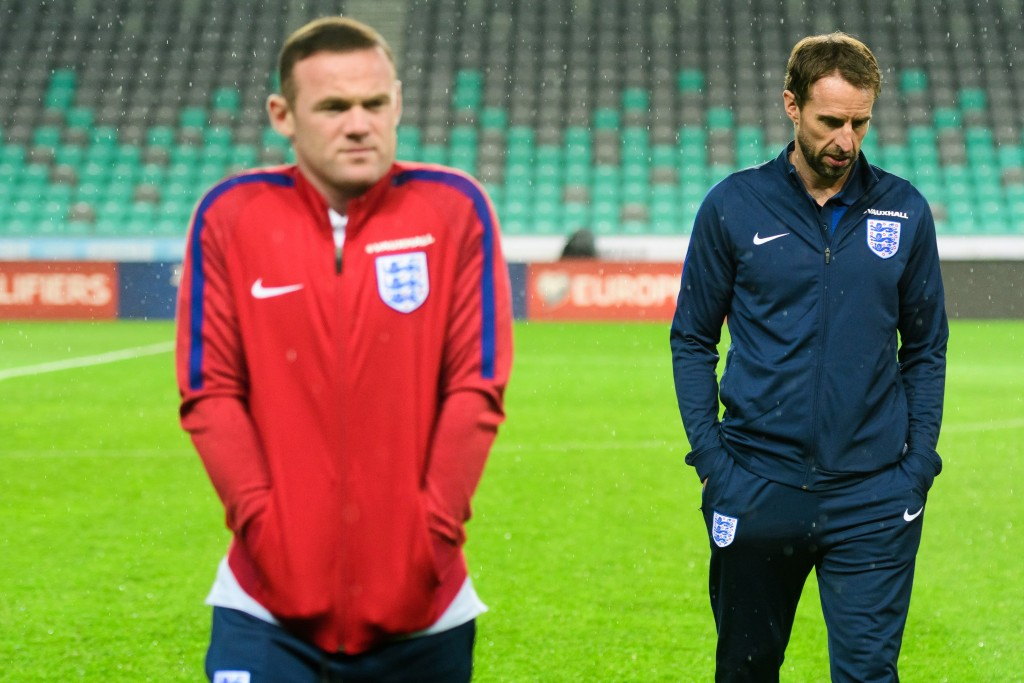 Interim England manager Gareth Southgate (R) and England's striker Wayne Rooney (L) walk on the pitch on the eve of the World Cup 2018 football qualification match between Slovenia and England in Ljubljana, on October 10, 2016 (Photo by Jure Makovec/AFP/Getty Images)