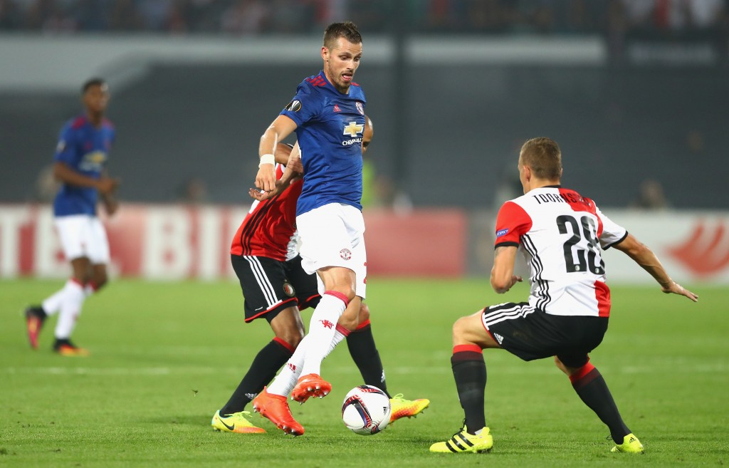 ROTTERDAM, NETHERLANDS - SEPTEMBER 15: Morgan Schneiderlin of Manchester United is put under pressure by Karim El Ahmadi and Jens Toornstra of Feyenoord during the UEFA Europa League Group A match between Feyenoord and Manchester United FC at Feijenoord Stadion on September 15, 2016 in Rotterdam, . (Photo by Dean Mouhtaropoulos/Getty Images)